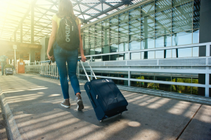 A woman heading towards her vacation